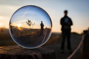 Moment captured through bubble with a man